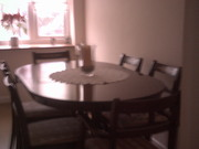Oval dark wood dining table and chairs